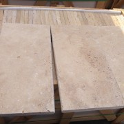 Travertine pool coping is ideal for the edges of a pool and as stair treads. 1.25″ or 2″ thick.